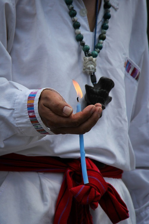 Guatemala priest holding candle