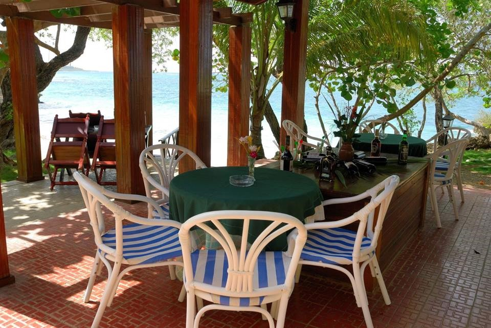 Table and chairs with seaview at Villa Maguana