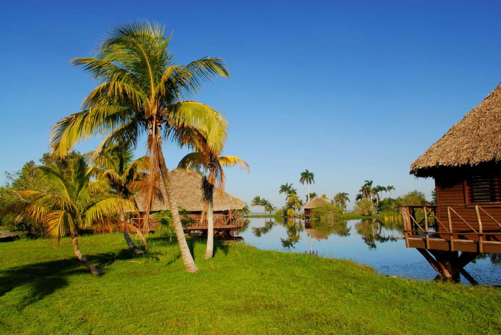 Cottages at Villa Guama resort and replica Taino village