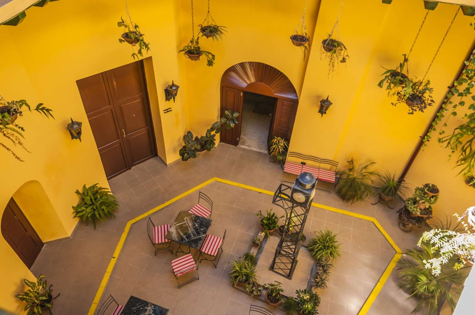 Bright yellow courtyard at Camino de Hierro