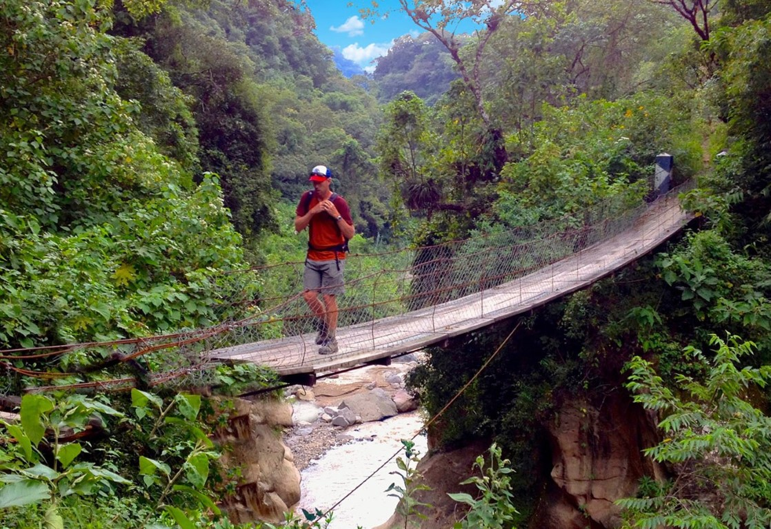 Crossing a hanging bridge while hiking in Guatemala