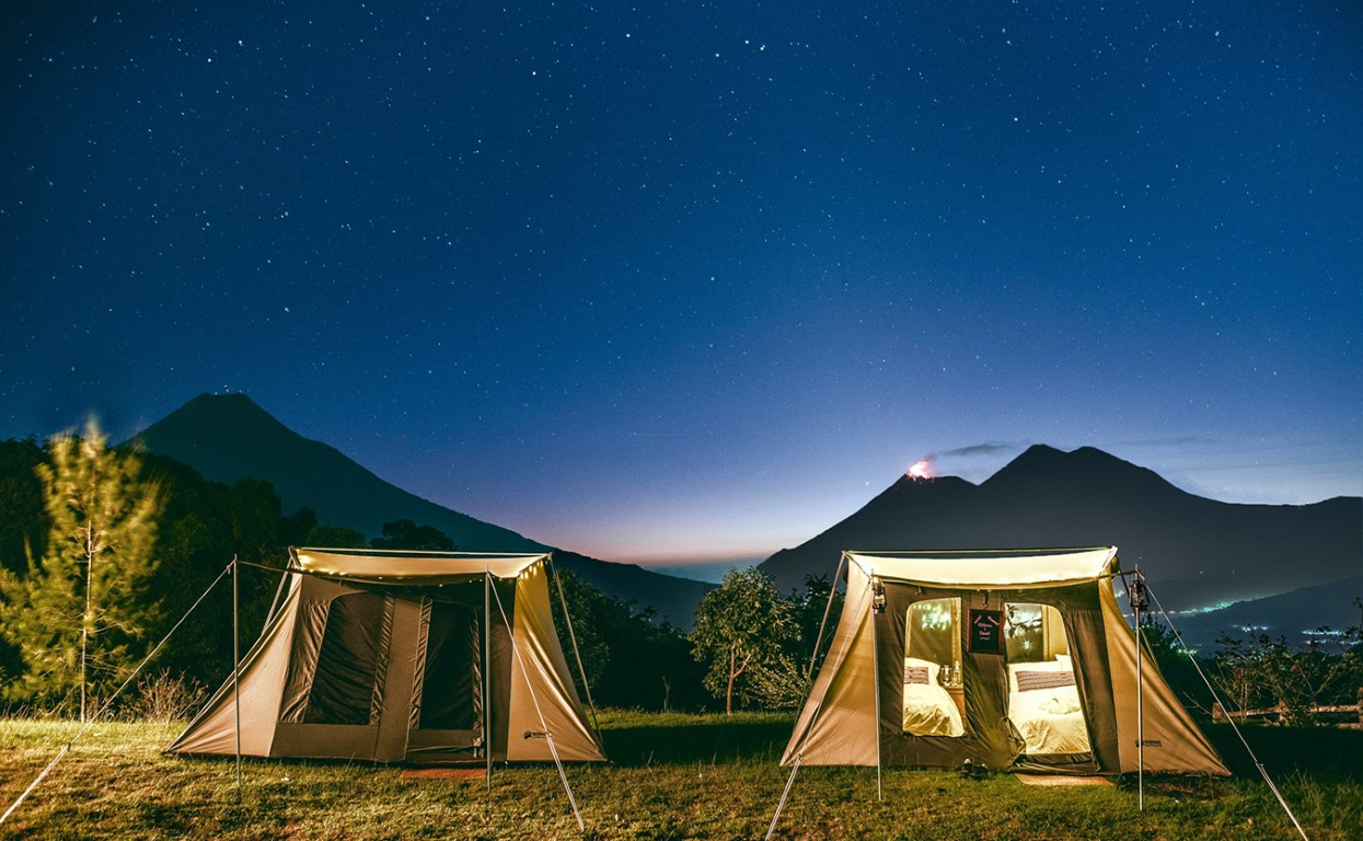Tents set against the night sky