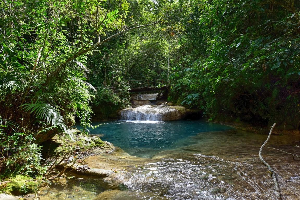 Hiking past waterfalls in Guanayara Park