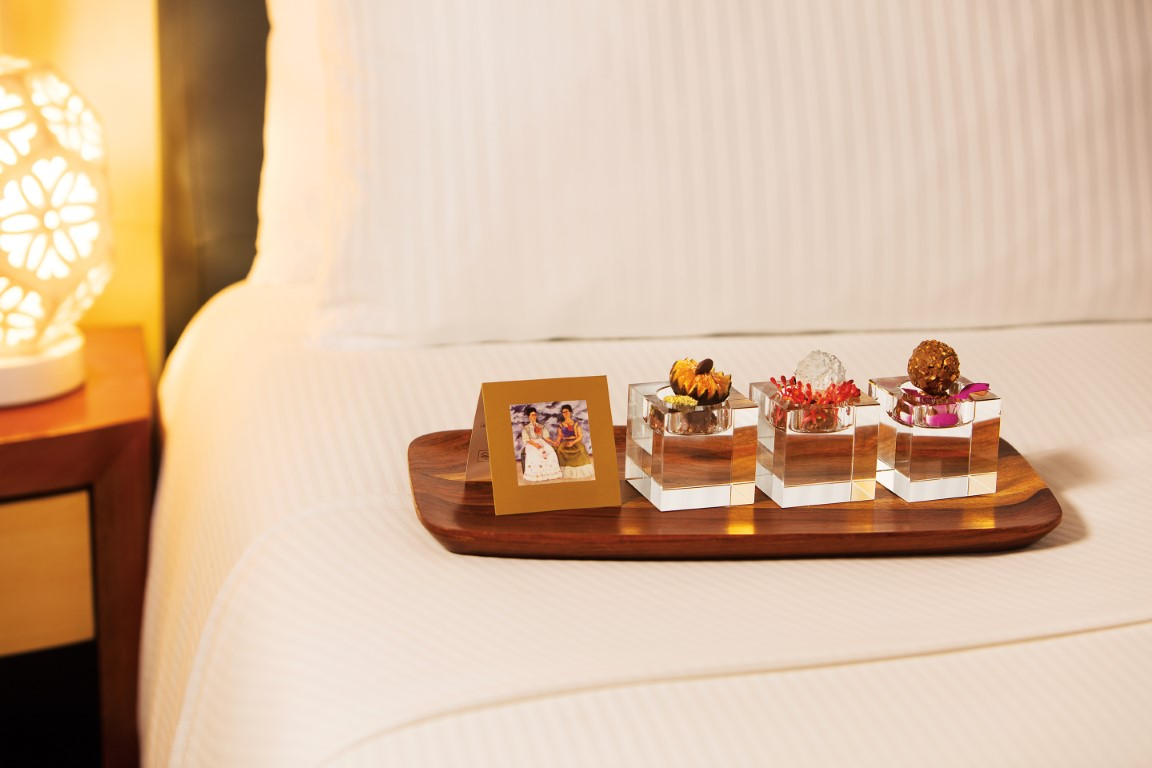 Chocolates on bed at Zoetry Villa Rolandi