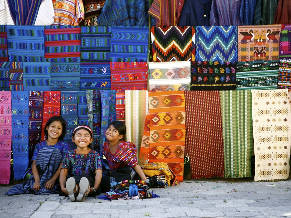 Three smiling Mayan girls at Solola Market