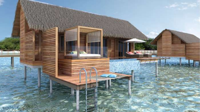 Luxury, wooden hotel bungalow on stilts above the sea