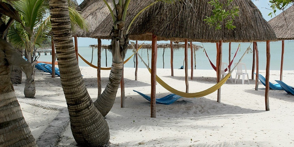 Beach with palapas and hammocks