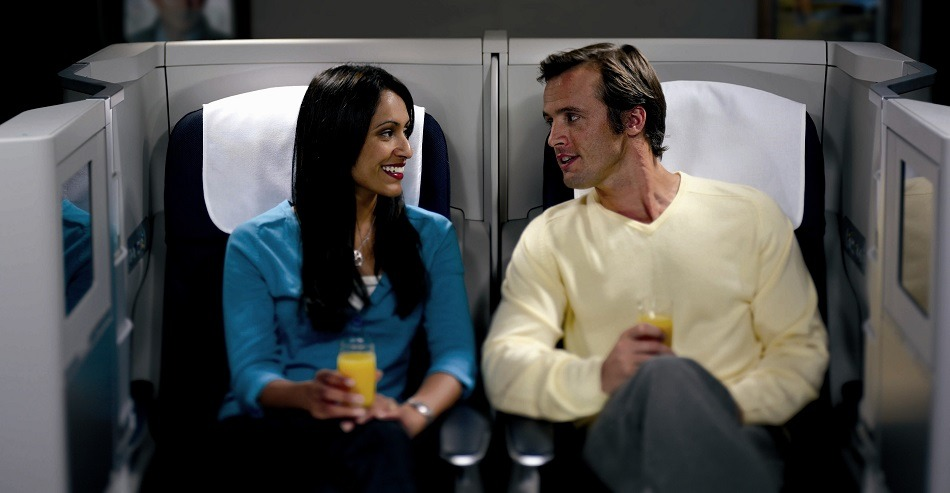 Couple in business class seats