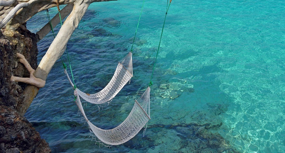 Hammocks over the sea in Cuba