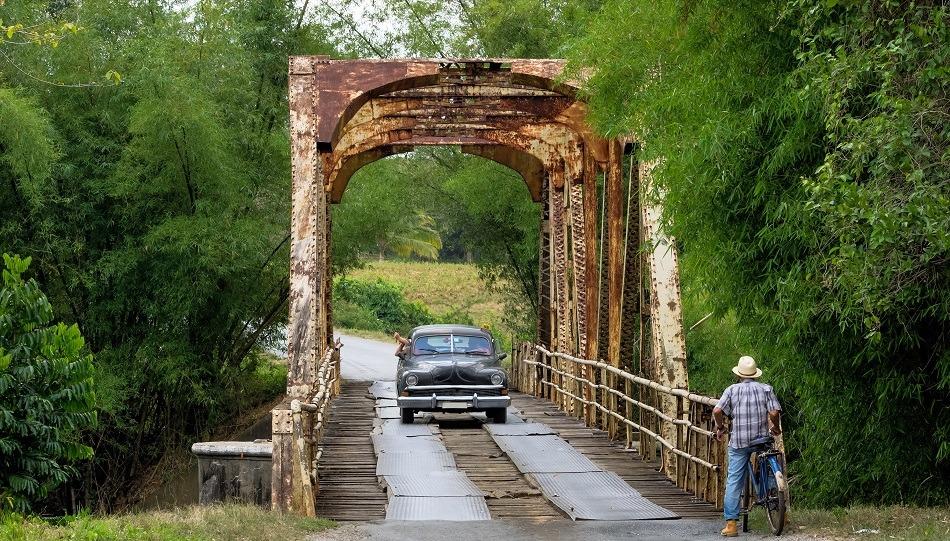 Car crossing bridge in Vinales Cuba