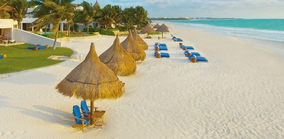 Palapas and beach beds on Playa Maroma Mexico