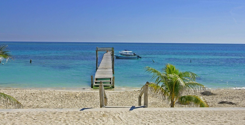 Jetty and boat in Puerto Morelos Mexico