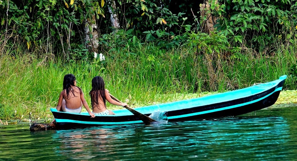 Two young children in a canoe