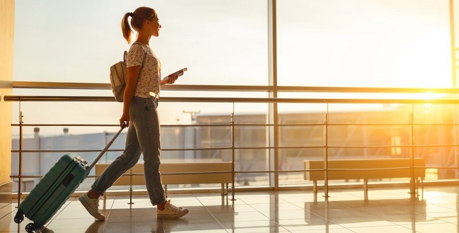 Woman at airport with suitcase