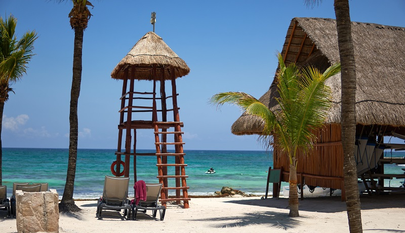 Watch tower and palapa by the beach in Mexico