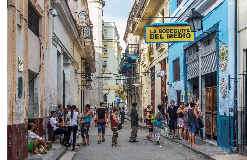 Customers on the street outside La Bodeguita Del Medio in Havana