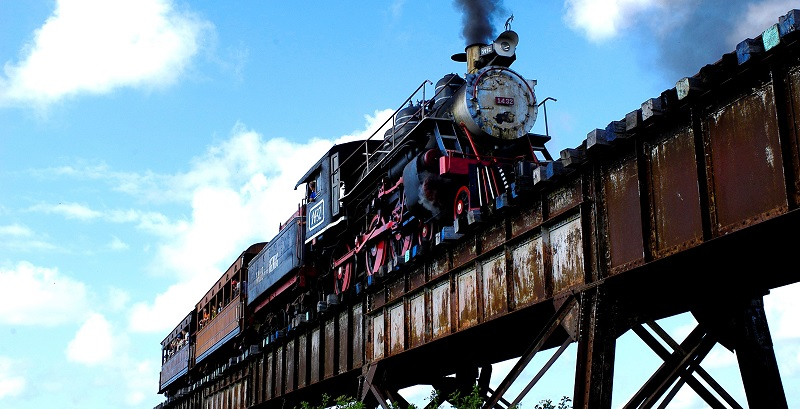 Steam train on a railway bridge in the Valley of the Sugar Mills