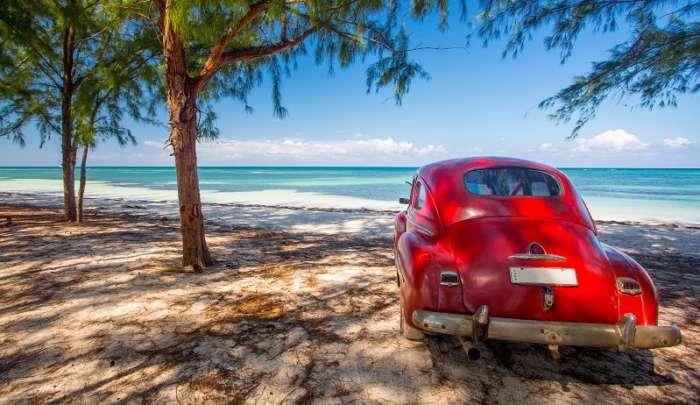 A vintage car on the beach in Cuba